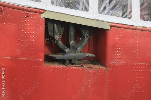 Keuken foto achterwand Schip Red vintage background with boat hull and ship anchor, Rotterdam, Netherlands.