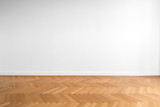 wooden parquet floor and white wall background   - 191792371