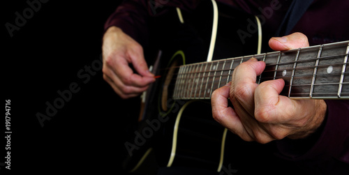 Playing an Acoustic Guitar. Closeup. Guitarist hands and guitar close up. Copy spaces.