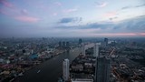 Day to night Time lapse of Bangkok residential district by the Chao Praya River at dusk, Thailand - 191815929