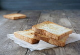 Slices of toasted bread on the table - 191826780