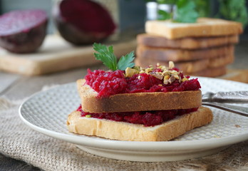 Toast with boiled beets, nuts and fresh parsley
