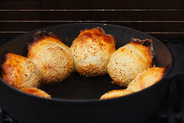 Samosa samsa baking in the cast-iron oven tandoor Traditional pastry of Central Asia countries