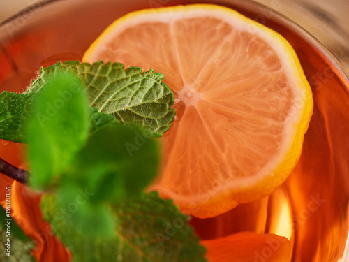 Hot tea with mint and lemon in a glass
