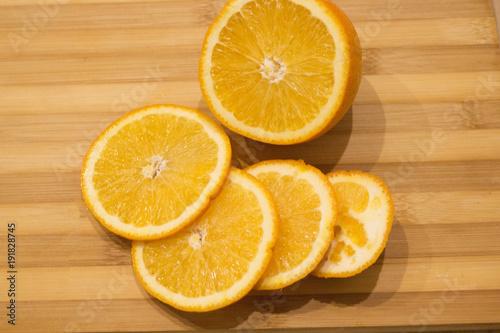 yellow juicy orange closeup on wooden table