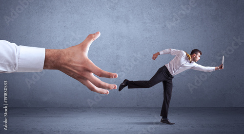 Businessman running from hand - 191830533