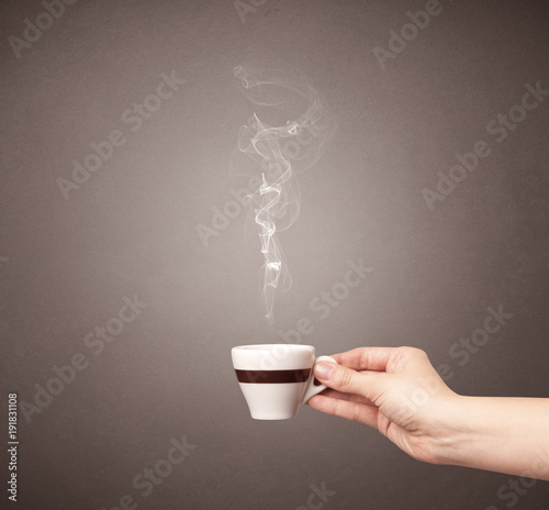Papiers peints Cafe Female hand holding coffee cup