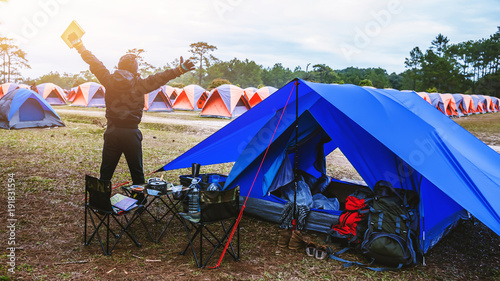 Fotobehang Diepbruine Asian man travel relax camping in the holiday. camping on the Mountain. relax read a book. Thailand