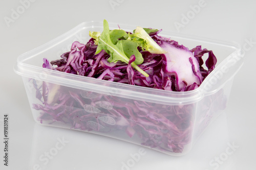 Vegetarian salad red cabbage with grated green apple, oil and vinegar in plastic take away bowl