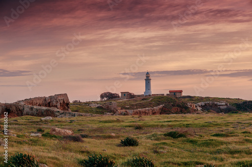 Foto op Canvas Cyprus Paphos, Cyprus, a beautiful landscape. Lighthouse at sunset