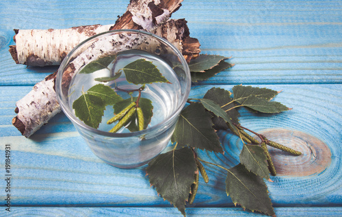 A glass of birch juice on wooden background - 191841931