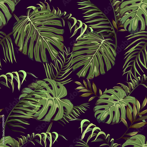 Seamless pattern with tropical leaves of palm trees on a dark background