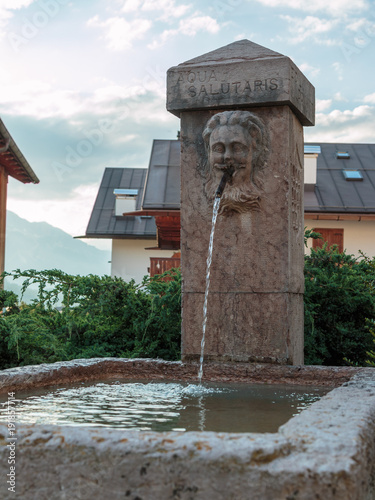 Public Fountain in Mountain's Village among Houses