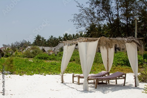 Fotobehang Zanzibar White sand beach in Zanzibar (Tanzania) with greenery and sitting area