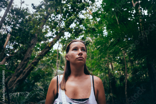 Travel lifestyle. portrait woman traveler in dense tropical forest