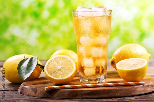 glass of lemon iced tea with fresh fruits