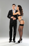 Sexy woman in underwear and businessman wearing suit on grey background - 191878123