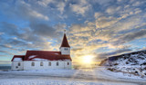 Typical red colored wooden church in Vik town, Iceland in winter. - 191879171