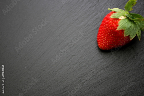 Foto Murales Strawberry on slate background