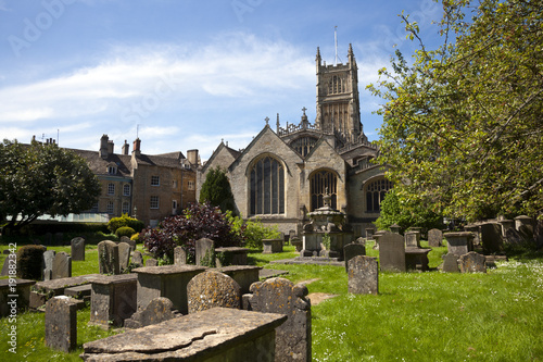 The historic Abbey Church and churchyard at Cirencester in the Cotswolds, Gloucestershire, UK