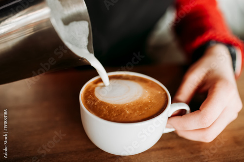 Papiers peints Cafe Barista is prepare making hot coffee cappuccino foam in white glass cup