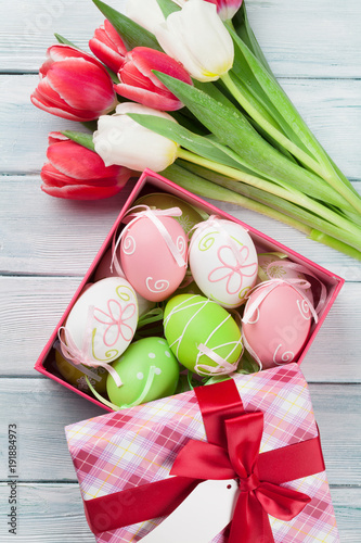 Plagát Easter eggs in gift box and colorful tulips