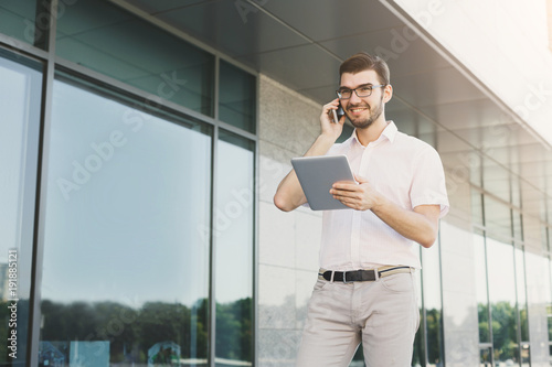 Young businessman working with papers outdoors