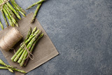 Bunch of fresh green asparagus on dark wooden background, top view - 191886974
