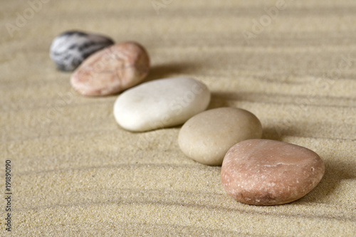 Foto op Plexiglas Stenen in het Zand Row of pebbles on sand
