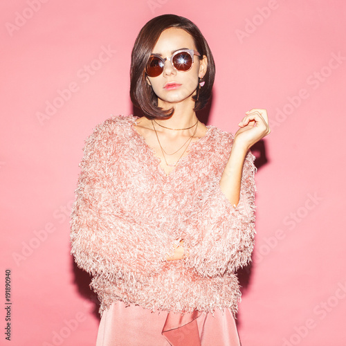 young female fashion model in pink total look on pink background