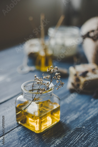 Foto op Plexiglas Spa Spa composition. Aroma essential oil on rustic wooden background, selective focus