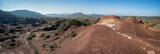 une vue panoramique sur des reliefs rasés et secs du sud de la France , de couleurs ocre et quelques montagnes en fond - 191894345