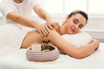 Woman getting classical back and neck massage © Prostock-studio