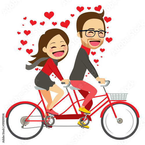 Panel Szklany Cute young couple on Valentine day riding on tandem bicycle celebrating love together