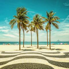 Palms on Copacabana Beach and landmark mosaic in Rio de Janeiro, Brazil. Vintage colors