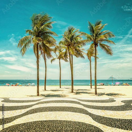 Palms on Copacabana Beach and landmark mosaic in Rio de Janeiro, Brazil. Vintage colors