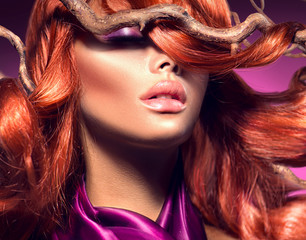 Red hair. Portrait of fashion sexy woman with long curly red hair