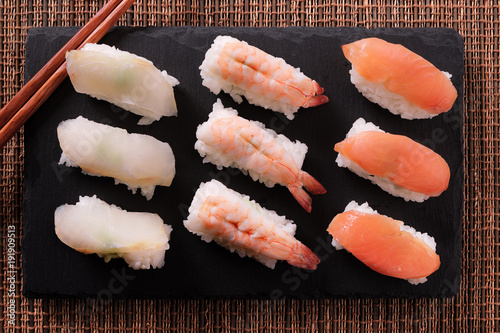 Tuinposter Sushi bar Japanese sushi food chopsticks flat lay