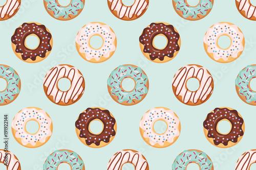 Bezszwowy wzór z oszklonymi donuts. Kolory niebieski i beżowy. Girly. Do druku i internetu.