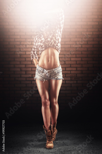Fitness motivation woman showing results of hard work