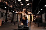 Strong, beautiful  woman athlete pushing sleds with weights in gym - 191936166