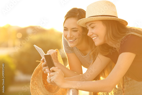 Tourists planning vacations in an hotel balcony