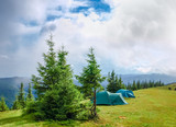 Mountain glade and two hiking tents in Carpathians after rain