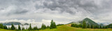 Panorama of the mountain glade in Carpathians in rainy weather