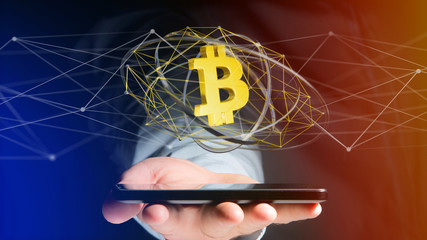 Businessman using a smartphone with a Bitcoin crypto currency sign flying around a network connection - 3d render