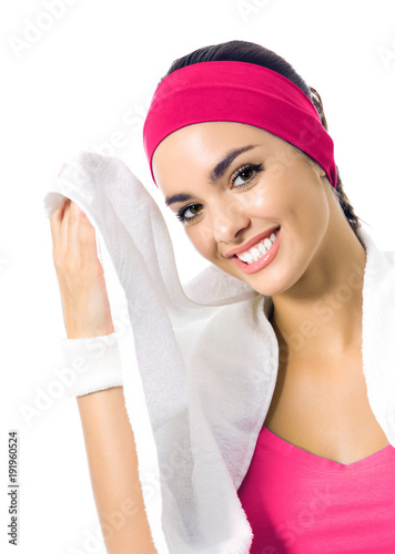 Woman in fitness wear with towel, isolated