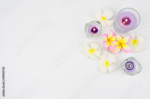Fotobehang Plumeria Background spa set.candle and plumeria flower on white background.