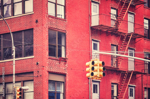 New York City traffic lights with building on background , color toned picture, USA.