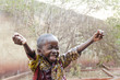 Water is coming! African ethnicity little boy happy to finally get some rain