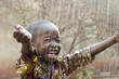 Quadro Little Native African Boy Standing Outdoors Under the Rain (Water for Africa Symbol)